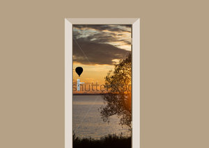 Deursticker luchtballon bij zonsondergang
