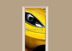 Deursticker gele auto