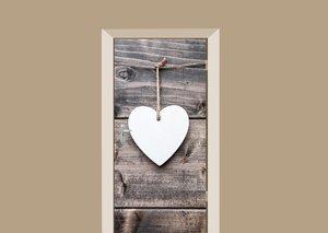 Deursticker wit hart op houten schuur