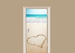 Deursticker hartje in het zand