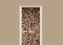 deursticker houtblokken stapels
